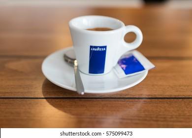 ZAGREB, CROATIA - FEBRUARY 4, 2017: Lavazza espresso  cup served on a plate with sugar and spoon.