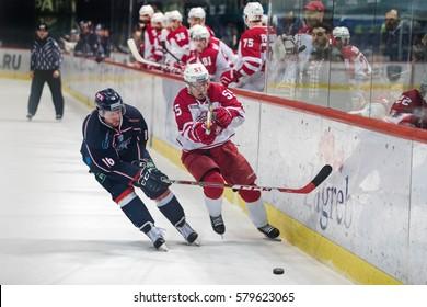 ZAGREB, CROATIA - FEBRUARY 5, 2017: KHL league 2016/2017- Medvescak Zagreb VS Vityaz Podolsk. Mike GLUMAC (16) and Aaltonen Miro (55)