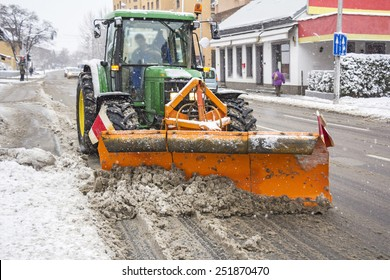 ZAGREB, CROATIA - FEBRUARY 6: Tractor plow, removes snow on one of the busiest streets on February  06, 2015 in Zabreb, Croatia.