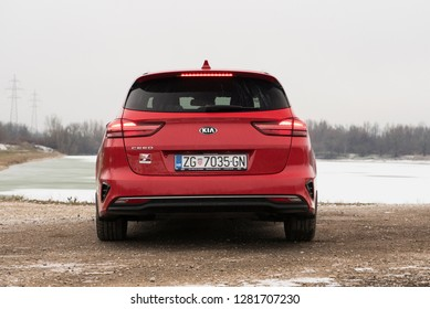 ZAGREB, CROATIA - JANUARY 05, 2019: New Kia Ceed SW in red colour. Brand new car. View from the back with frozen lake in background.