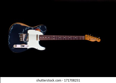 ZAGREB , CROATIA - JANUARY 14 ,2014 : fender telecaster black Joe Strummer style electric guitar on black background , product shot