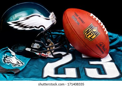 ZAGREB , CROATIA - JANUARY 15 ,2014 :   official american football NFL equipment , ball , helmet and jersey by Philadelphia Eagles club, product shot