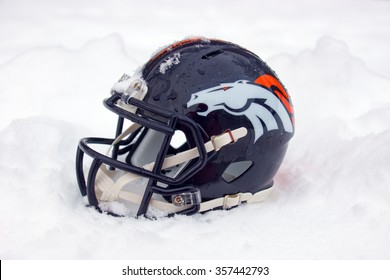 ZAGREB , CROATIA - January 1ST 2016 -  Denver Broncos NFL club helmet in the snow and ice , product shot