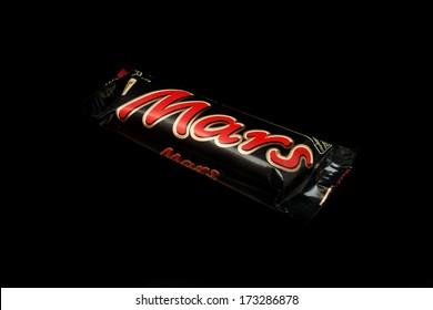ZAGREB , CROATIA - JANUARY 24 ,2014 : chocolate candy bar Mars on black background , product shot