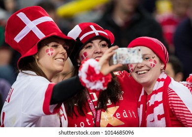 ZAGREB, CROATIA - JANUARY 29, 2018: EHF EURO Croatia 2018, Bronze medal match. France VS Denmark. Danish fans on stands taking selfies.