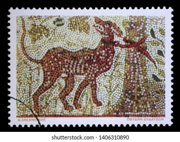 ZAGREB, CROATIA - JULY 03, 2014: A stamp issued in Yugoslavia shows Cerberus, mosaic series, circa 1970.