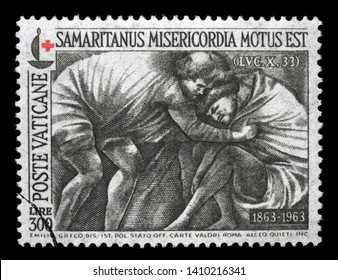 "ZAGREB, CROATIA - JULY 03, 2014: A stamp printed in Vatican shows ""The Good Samaritan,"" by Sicilian sculptor Emilio Greco, Red Cross series, circa 1964."