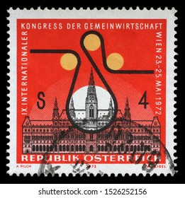 ZAGREB, CROATIA - JULY 03, 2014: A stamp issued in the Austria shows Vienna city hall and congress badge, the 9th International Cooperative Economic Convention, circa 1972.