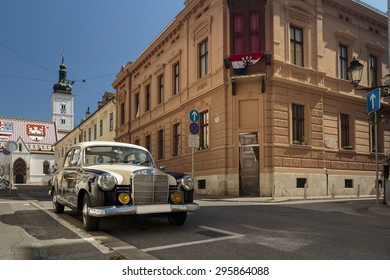 ZAGREB, CROATIA - JULY 11, 2015: Old two tone Mercedes from 60s parked on St. Mark's Square