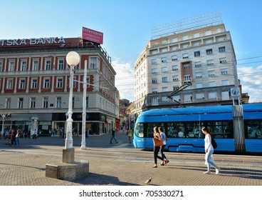 ZAGREB, CROATIA - JULY 14, 2017. Street view with blue tram in the central Jelacica Square in Zagreb, top attraction for many tourists in the capital of Croatia.