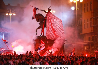 ZAGREB, CROATIA - JULY 15, 2018 : Croatian football fans celebrate second place after losing from France 4-2 in the finals on the World Cup 2018 FIFA on Ban Jelacic Square in Zagreb, Croatia.
