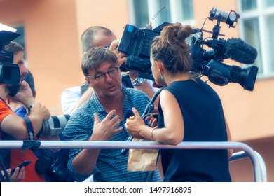 ZAGREB, CROATIA, July 15 2018: Various televisions crew members among fans of  Croatian national soccer team during final game of FIFA World Cup 2018, in Zagreb, Croatia.