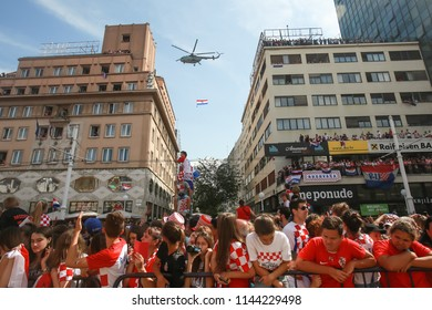 ZAGREB, CROATIA - JULY 16, 2018 : Croatia National Team welcome home celebration for 2nd place on Fifa World Cup 2018. Military helicopter Mil Mi-8 with flag fly around Ban Jelacic square.