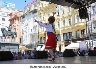 ZAGREB, CROATIA - JULY 16: Folk group Selkirk, Manitoba, Ukrainian Dance Ensemble Troyanda from Canada during the 48th International Folklore Festival in center of Zagreb, Croatia on July 16, 2014