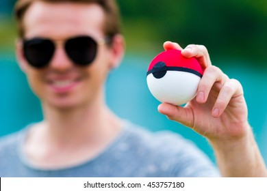 Zagreb, Croatia - July 17, 2016: Poke Ball (Pokemon Ball) in hands. Event was organized in Zagreb in wich people collected Pokemon's.