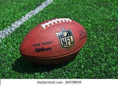 ZAGREB , CROATIA - JULY 18 ,2014 :  official ball of the NFL football league , the Duke on grass turf background , product shot