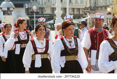 ZAGREB, CROATIA - JULY 18: Members of folk group Kumpanjija from Blato, island of Korcula, Croatia during the 49th International Folklore Festival in center of Zagreb, Croatia on July 18, 2015