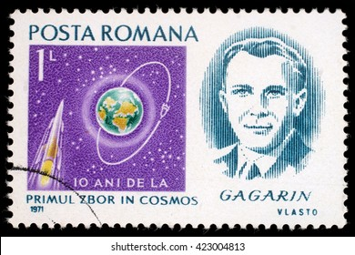 """ZAGREB, CROATIA - JULY 19: A stamp printed in Romania shows portrait of Yuri Gagarin with inscription """"10 anniversary of first manned space flight"""", circa 1971, on July 19, 2012, Zagreb, Croatia"""