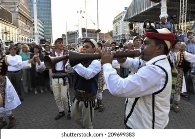 ZAGREB, CROATIA - JULY 20:Members of folk group Albanian Culture Society Jahi Hasani from Cegrane, Macedonia during the 48th International Folklore Festival in center of Zagreb,Croatia on July 20,2014