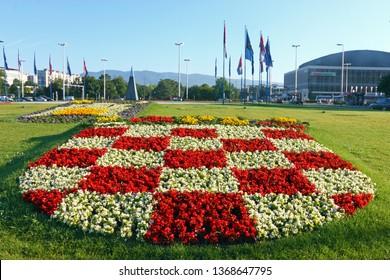 ZAGREB, CROATIA – JULY 4,  2014: Croatian coat of arms in a park near Vatroslav Lisinski concert hall, Zagreb, Croatia