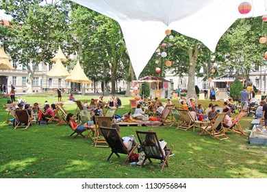 ZAGREB, CROATIA - JULY 7TH, 2018 :Open Festival in the City Park Zrinjevac when many people are socializing with reading books and drinks in Zrinjevac park in Zagreb, Croatia.
