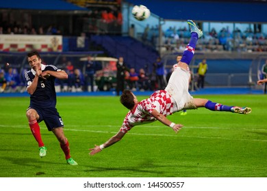 ZAGREB, CROATIA - JUN 07: 2014 FIFA World Cup Brazil Preliminaries: Croatia VS. Scotland June 07, 2013 Zagreb, Croatia. Mario MANDZUKIC (right) doing scissor kick
