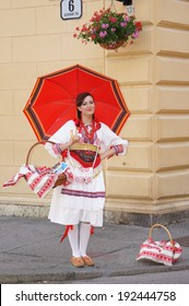 Zagreb, Croatia- Jun 21,2013:  A woman wearing Croatian traditional costume