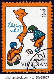 ZAGREB, CROATIA - JUNE 12, 2019: a stamp printed in Vietnam shows children drawing map of unified Viet Nam, circa 1977
