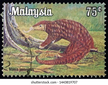 ZAGREB, CROATIA - JUNE 12, 2019: a stamp printed in Malaysia shows Malayan pangolin, manis javanicus, is a species of pangolin, circa 1979