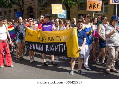 ZAGREB, CROATIA - JUNE 13, 2015: Zagreb's gay pride participants on street holding banners.
