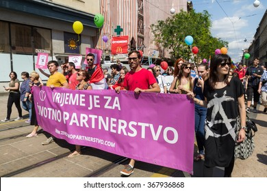 ZAGREB, CROATIA - JUNE 14, 2014: LGBT people holding pink banner on Zagreb's gay pride.