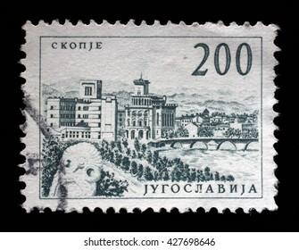 "ZAGREB, CROATIA - JUNE 14: Stamp printed in Yugoslavia shows a Bridge at Skopje, with inscription ""Skopje"", from series ""Industrial Progress"" circa 1958, on June 14, 2014, Zagreb, Croatia"