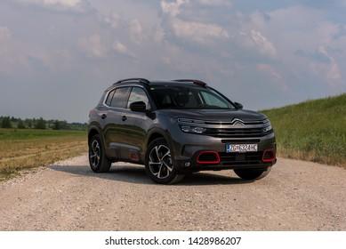 ZAGREB, CROATIA - June 16, 2019: New Citroen SUV C5 Aircross in gray colour on the dusty road.