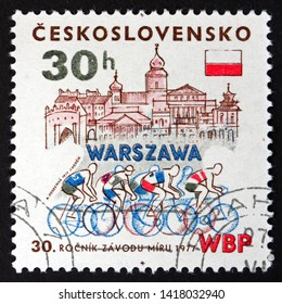 ZAGREB, CROATIA - JUNE 2, 2019: a stamp printed in Czechoslovakia shows Warsaw and bicyclists, 30th international bicycle peace race Warsaw-Prague-Berlin, circa 1977