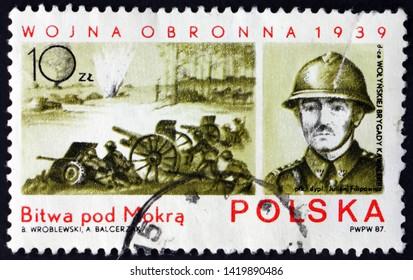 ZAGREB, CROATIA - JUNE 2, 2019: a stamp printed in Poland shows Battle of Mokra, World War II battle, and Colonel Julian Filipowicz, circa 1987