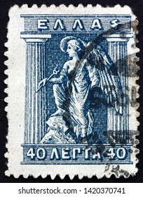 ZAGREB, CROATIA - JUNE 2, 2019: a stamp printed in Greece shows Iris Holding Caduceus, Iris is Personification of the Rainbow and Messenger of the Gods, Greek Mythology, circa 1914