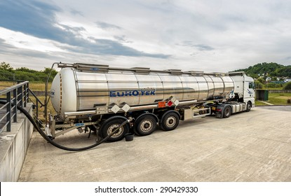 ZAGREB, CROATIA - JUNE 23, 2015: Tank truck unloading dangerous flammable goods Isopropyl alcohol into the inner tank storage of chemicals warehouse