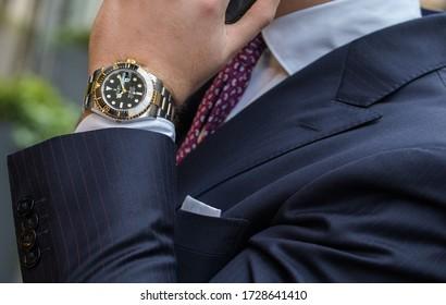 Zagreb, Croatia, June 24, 2019, Man wearing Rolex SeaDweller Steel Gold.  Illustrative editorial.