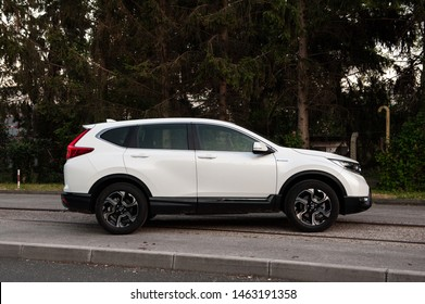 ZAGREB, CROATIA - JUNE 29, 2019: New Honda CR-V Hybrid. Modern SUV transport vehicle. White 4x4 Honda CR-V.