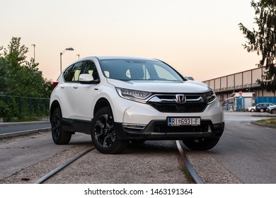 ZAGREB, CROATIA - JUNE 29, 2019: New Honda CR-V Hybrid. Modern SUV transport vehicle. White 4x4 Honda CR-V. Front view of the car.