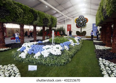 ZAGREB, CROATIA - JUNE 3, 2016 : People sightseeing a prize winning garden installation of the general impression of the exhibition space, exhibited at Floraart at Bundek in Zagreb, Croatia.