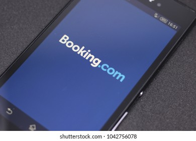 ZAGREB, CROATIA - MARCH 10, 2018. Booking.com android app on black background. Booking.com is a travel fare aggregator website and travel metasearch engine for lodging reservations.