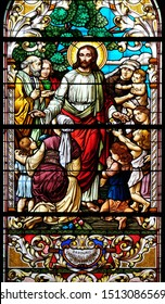 ZAGREB, CROATIA - MARCH 11: Jesus blesses mothers with children, stained glass window in the Saint John the Baptist church in Zagreb, Croatia, on March 11, 2017.