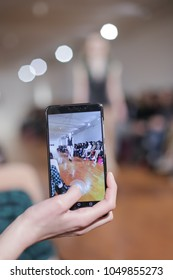 ZAGREB, CROATIA- MARCH 15, 2018: Audience filming with smartphone video of fashion model wearing clothes for spring-summer, designed by I-GLE on the Bipa Fashion.hr fashion show in Zagreb, Croatia.