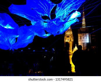 ZAGREB, CROATIA - MARCH 16, 2018: Festival of lights Zagreb: Light installation of magnolia flower above the Gradec plateau, in front of Zagreb cathedral