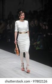 "ZAGREB, CROATIA - MARCH 16: Fashion model wears clothes made by Aleksandra Dojcinovic on ""Dove FASHION.HR"" show on March 16, 2012 in Zagreb, Croatia."