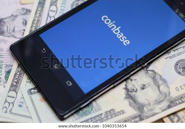 ZAGREB, CROATIA - MARCH , 2018: Coinbase android app on dollar background. Coinbase is a digital currency exchange.
