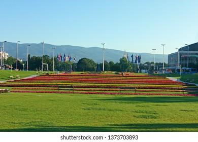 ZAGREB, CROATIA - MARCH 21, 2014: Seasonal flowers planted in striped flower beds in a park