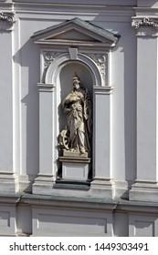ZAGREB, CROATIA – MARCH 21, 2014: Saint Catherine of Alexandria statue on the facade of St. Catherine church in Zagreb