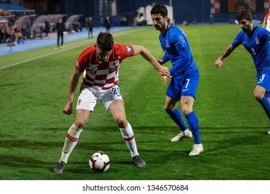 ZAGREB, CROATIA - MARCH 21, 2019: UEFA EURO 2020 Qualifying round, Group E. Croatia VS Azerbaijan. Bruno PETKOVIC (20) and Araz ABDULLAYEV (7)